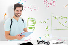 Composite image of student using tablet pc Stock Image