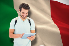 Composite image of student using tablet pc royalty free stock photography