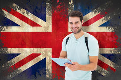 Composite image of student using tablet pc Royalty Free Stock Images