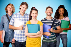 Composite image of students holding folders in college. Students holding folders in college against blue background with vignette Stock Image