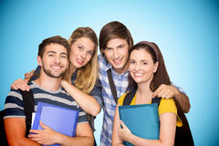 Composite image of students holding folders at college corridor Royalty Free Stock Photo