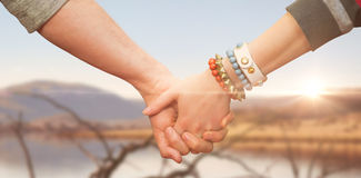 Composite image of students holding hands Royalty Free Stock Image
