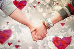 Composite image of students holding hands Royalty Free Stock Photos