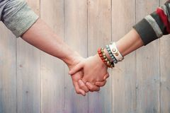 Composite image of students holding hands Royalty Free Stock Photo