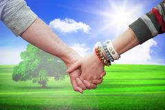 Composite image of students holding hands Stock Photography