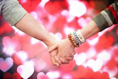 Composite image of students holding hands Stock Images
