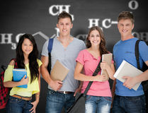 Composite image of students looking at the camera as they hold notepads Royalty Free Stock Photos