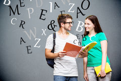 Composite image of students reading in the library Royalty Free Stock Image