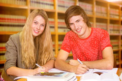 Composite image of students studying Stock Photography