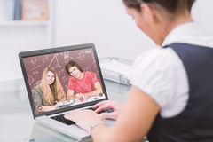 Composite image of students studying Stock Image