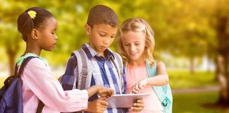 Composite image of students using digital tablet royalty free stock image