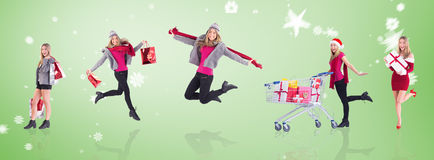 Composite image of stylish blonde holding shopping bags Stock Images