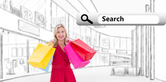 Composite image of stylish blonde in red dress holding shopping bags Stock Images