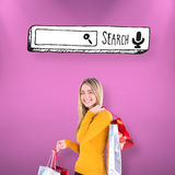 Composite image of stylish blonde smiling with shopping bags Stock Photo