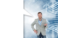 Composite image of stylish man smiling and gesturing with speech bubble Royalty Free Stock Image