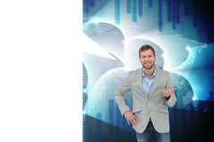 Composite image of stylish man smiling and gesturing with speech bubble Royalty Free Stock Images