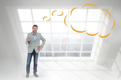Composite image of stylish man smiling and gesturing with thought bubble Royalty Free Stock Photos