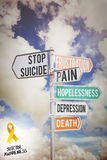 Composite image of suicide awareness ribbon. Suicide awareness ribbon against multi colored sign posts against cloudy sky stock image