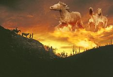 Composite image of a sunset in the western desert with fiery spectral ghost horses in the sky Stock Photos