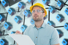 Composite image of supervisor looking away while writing on clipboard. Supervisor looking away while writing on clipboard against blue 3d houses in an estate Stock Photography