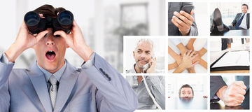 Composite image of suprised businessman looking through binoculars Royalty Free Stock Images