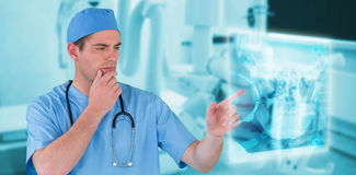 Composite image of surgeon pretending to be using futuristic digital screen Stock Images