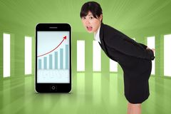 Composite image of surpised businesswoman bending Stock Images