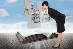 Composite image of surpised businesswoman bending Stock Photos