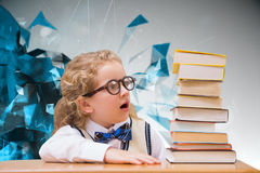 Composite image of surprise pupil looking at books Royalty Free Stock Photos