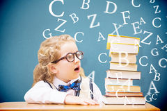 Composite image of surprise pupil looking at books Stock Images