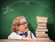 Composite image of surprise pupil looking at books Stock Photography
