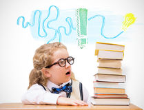 Composite image of surprise pupil looking at books Stock Photo