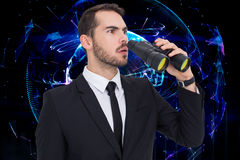 Composite image of surprised businessman standing and holding binoculars. Surprised businessman standing and holding binoculars  against global technology Royalty Free Stock Photo