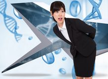 Composite image of surprised businesswoman bending Royalty Free Stock Photography