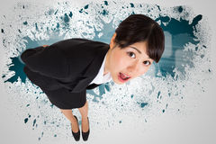Composite image of surprised businesswoman bending Stock Photos