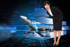 Composite image of surprised businesswoman bending Royalty Free Stock Photo