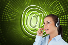 Composite image of at symbol and call centre worker Royalty Free Stock Photo