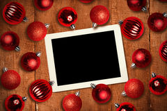 Composite image of tablet pc Stock Images