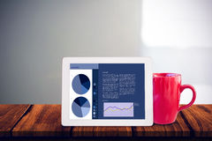 Composite image of tablet pc. Tablet pc against steaming cup of coffee Stock Photography