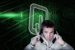 Composite image of tablet pc and businessman tangled in wires Stock Photo