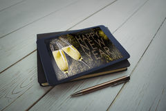 Composite image of tablet and pen on desk Royalty Free Stock Photo