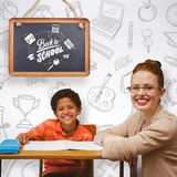 Composite image of teacher helping pupil. Teacher helping pupil against grey background Royalty Free Stock Image