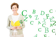Composite image of teacher reading book at library Stock Image