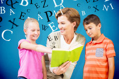 Composite image of teacher reading book with pupils at library Royalty Free Stock Image