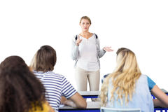 Composite image of teacher teaching students in class Stock Photo