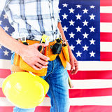 Composite image of technician with tool belt around waist and hard hat Royalty Free Stock Image