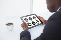 Composite image of telephone with apps icon. Telephone with apps icon  against businessman using digital tablet Royalty Free Stock Image