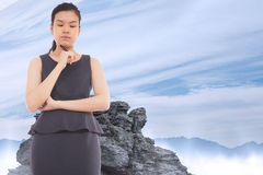 Composite image of thinking asian businesswoman Royalty Free Stock Photography