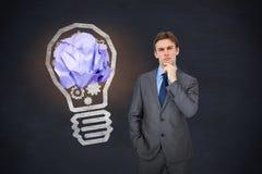 Composite image of thinking businessman. Thinking businessman against blackboard stock photography