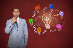 Composite image of thinking businessman. Thinking businessman against image of a desk royalty free stock photography